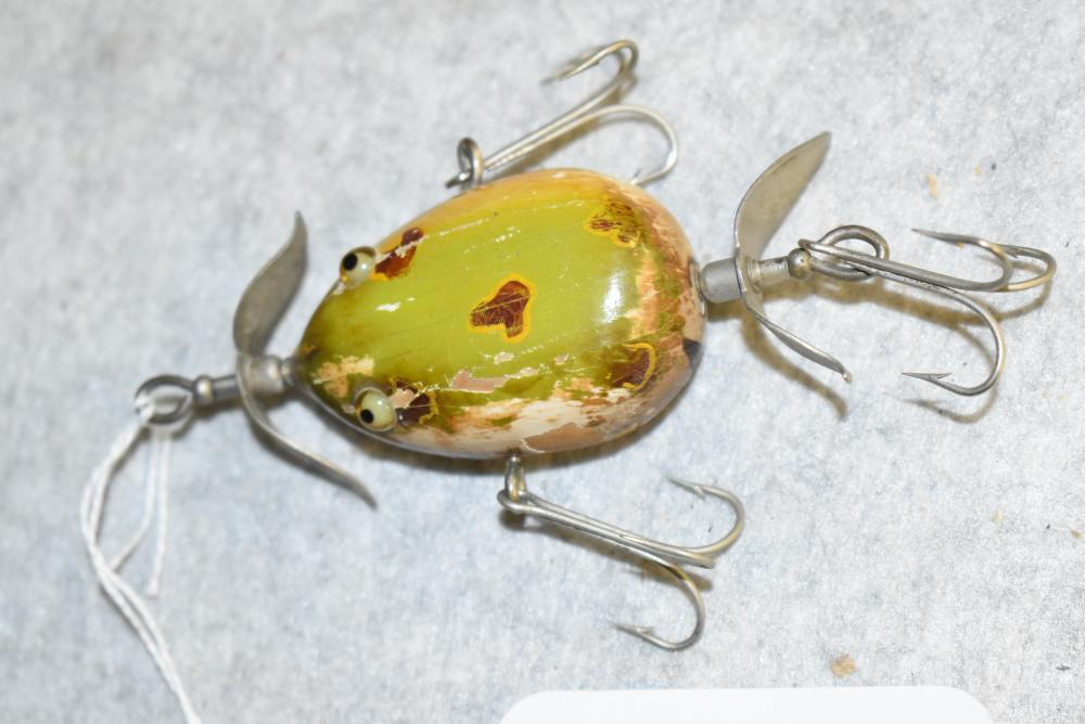"""Early Kent Frog by Pflueger. Front prop is marked w a """"R"""", the back prop has a """"L"""". frog has glass eyes, large paint chip on"""