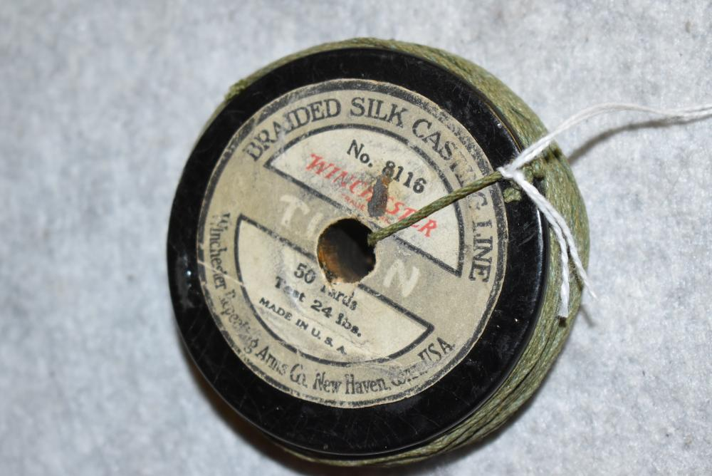 Winchester No. 8116 casting line on wooden spool, 50 yards 24lb. test, both labels are punched