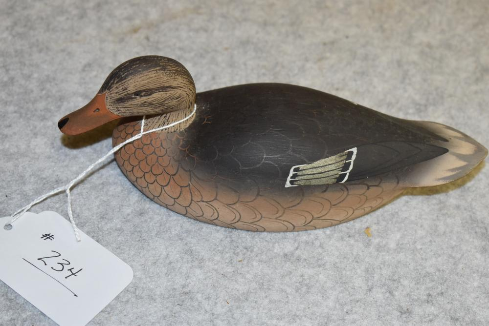 """Ken Harris, carved miniature hen mallard decoy w glass eyes, felt on bottom, ink stamped """"Made by Ken Harris-Woodville, NY. Excellent condition, measures 8"""" overall."""