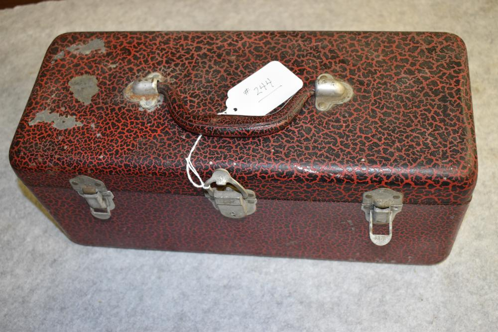 Heddon-Outing, labeled red crackle back metal tackle box. Selling with various assorted tackle items. 2 trays with painted label In bottom of top tray. Heddon decal label inside the lid. Some paint chips on the top. (Hard to find color)