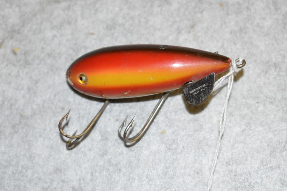 Winchester Multi-Wobbler.  Rainbow finish glass eyes.  Some small paint chips & hook pointers.  Paint loss on nose.  Stamped on the diving plane #9206 (Very Good)