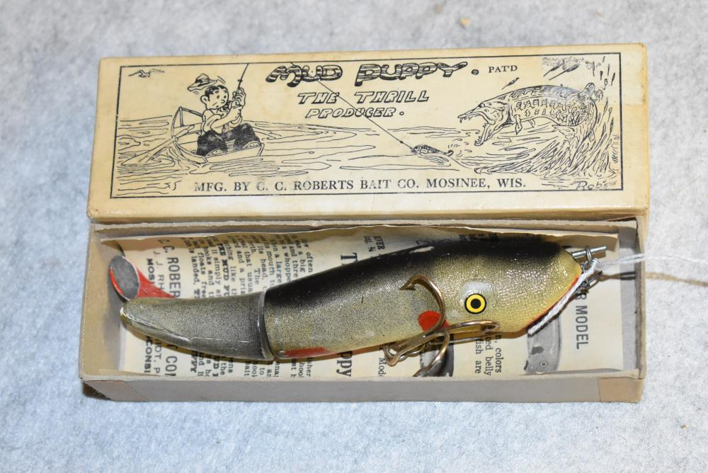 """Mud Puppy – The Thrill Producer.  Patented by C.C. Roberts.  Lure is in the original box w/Paper.  The lure is in excellent condition.  The painted metal tail has some paint flaking.  P.E. 5 ¼"""" in length.  The box shows some soiling. (EXC)"""