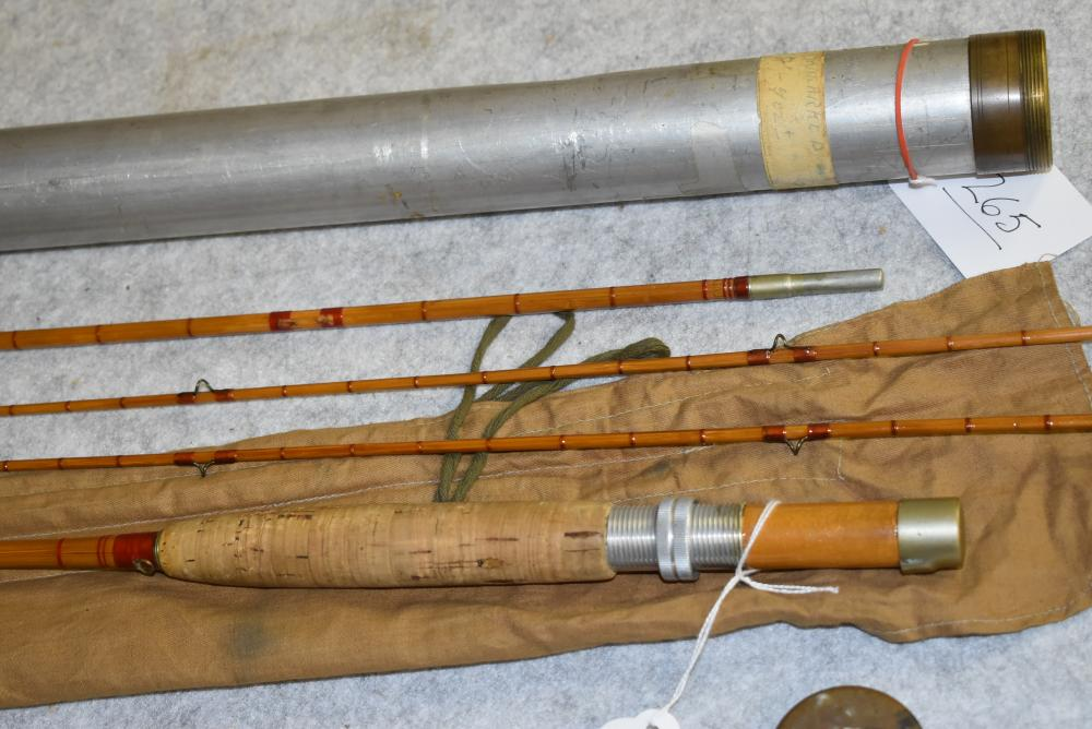 """Unsigned 4pc. bamboo fly rod in bag & metal tube.  The butt & Mid sections are short.  Has the intermediate wraps.  Missing a few guides.  The butt measures 29"""", Mid 31"""" & Tips 36"""" each.  The tube has brass ends on it."""
