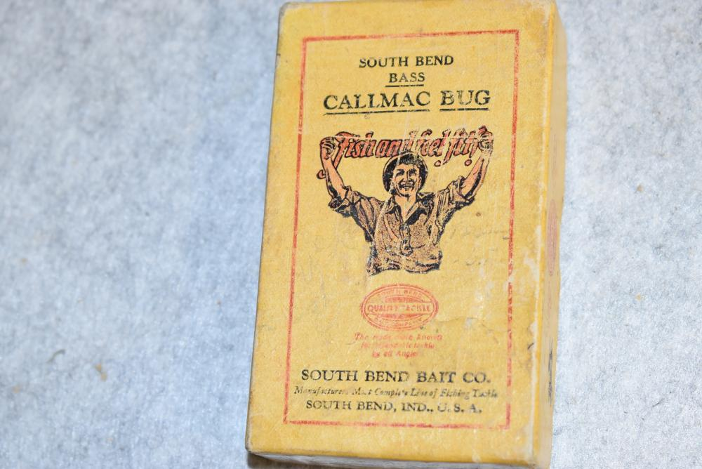 South Bend Callamac Bug in the original box.  The box end label reads:  No. 12 Dr. Henshaw.  The fly rod lure has a chip above it's left eye.  The box is scuffed, corners are intact (Good+)
