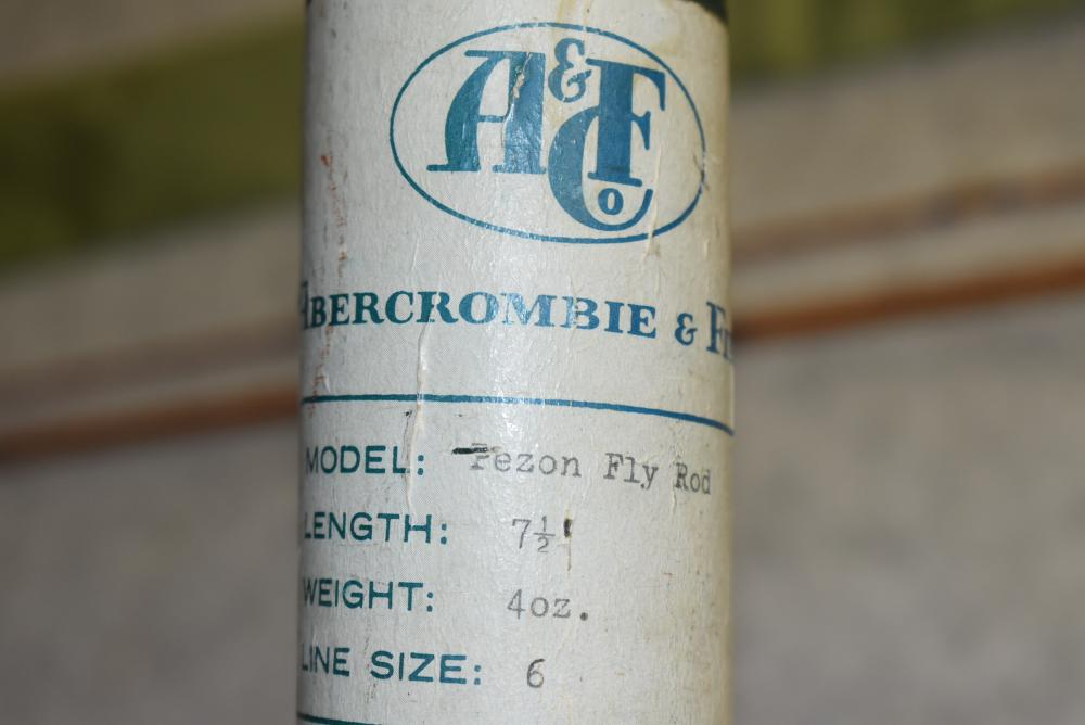 """A&F Pezon Fly Rod in Labeled Bag & Tube – 7½' 2 Pc. Bamboo Fly Rod w/Ferrule Plug – Rod has """"7½ Fast-Action"""" Written on Finish - Made in France – Exclusively for Abercrombie & Finch By: Pezon Et. Michel – Cork Handle Still Has A&F Price Sticker Intact – Rod is Clean w/Very Little Use"""