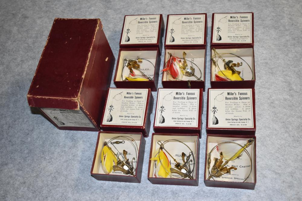 """Rare Miller's Famous Reversible Spinners in Dealer Box w/6 Individually Boxes Lures – This is the Only Full Dealer Box Known – The Box Top has 2 Corners Split – the Box Bottom has a 2"""" Split on the Corner to the Right of the Box Label – Each of the Individual Boxes Contains a Spinner w/Wire Lead & the Box Paper: Rules for Practical Bait Casting – Dealer Box Label Shows Some Staining"""