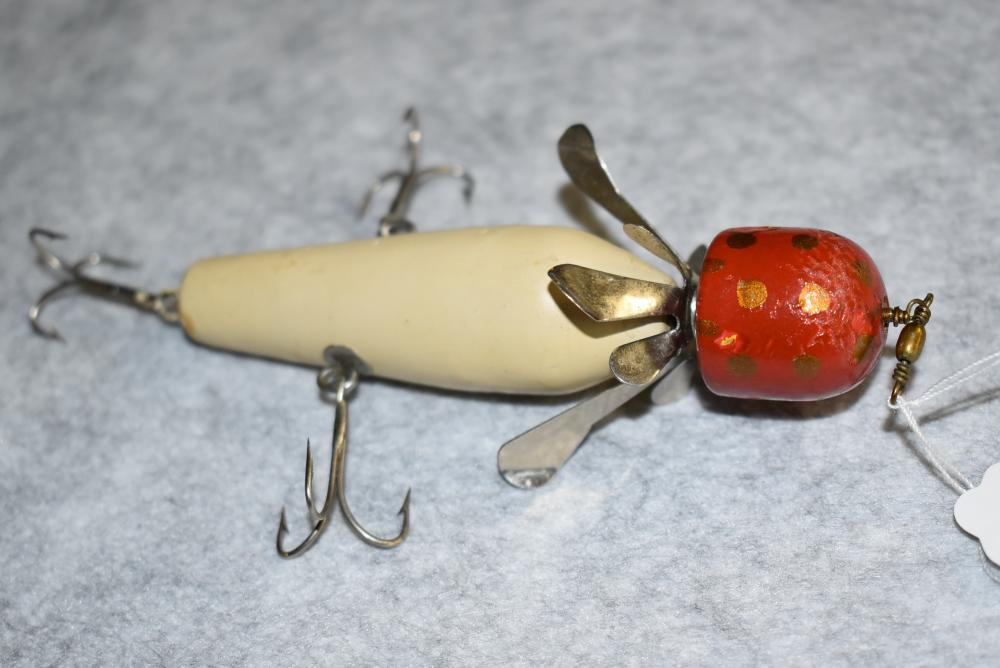 """Miller's Prototype Rotary Head Minnow – Measures 4¼"""" in Length – Red Head w/Gold Spots & White Body – Wire Through the Body – 2 Side Hooks w/ Screw Eye & Washer Hardware – Spinner is a Miller's Standard Spinner – Some Hook Pointers – Finish Blemishes"""
