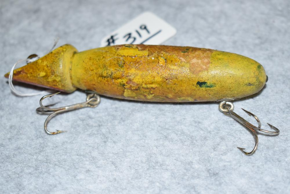"""Miller's Prototype Minnow – Measures 5"""" in Length – Has Curved Slant Face on the Head – Solid Yellow/Green Finish w/ Red Chin – 2 Belly Hooks w/ Screw Eye & Washer Hardware – Finish Blemishes Overall – Tail Nail."""
