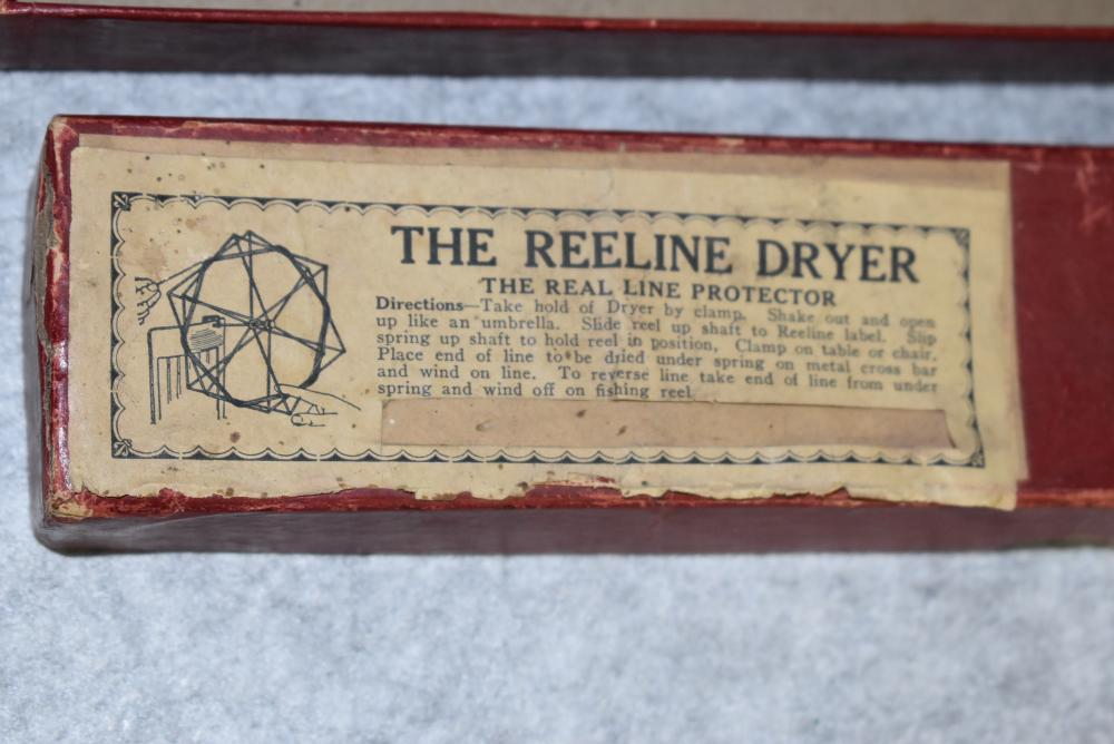 The Reeline drier in the original box. Box has the original label on top. Two piece maroon box. The drier clamps on a table and folds in or out. It is adjustable.