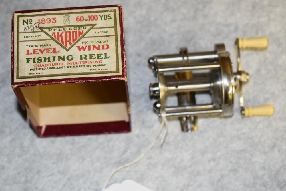 Pflueger Akron No. 1893 casting reel in the original maroon box. Very clean, appears unused w paperwork.