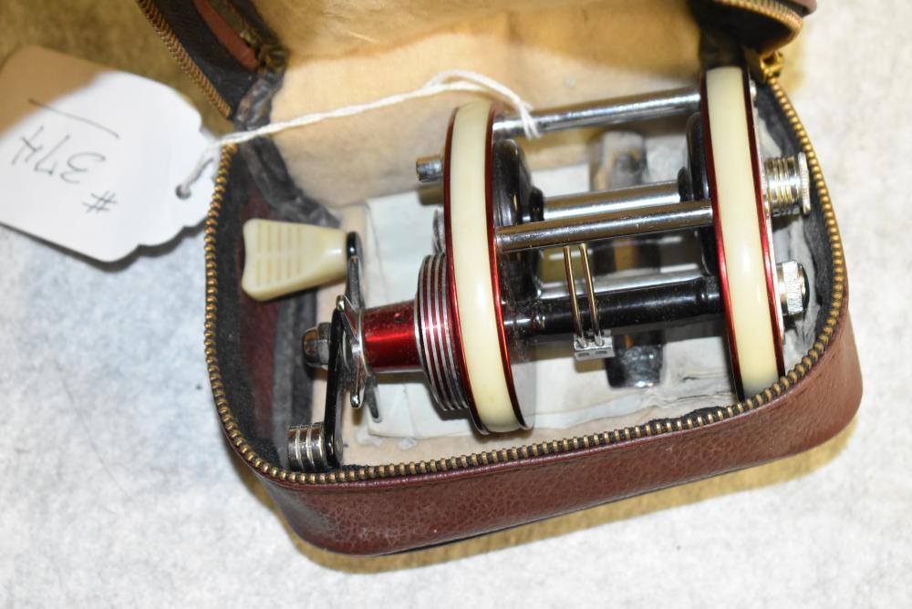 J.A. Coxe Invader #26 casting reel in zippered vinyl case.