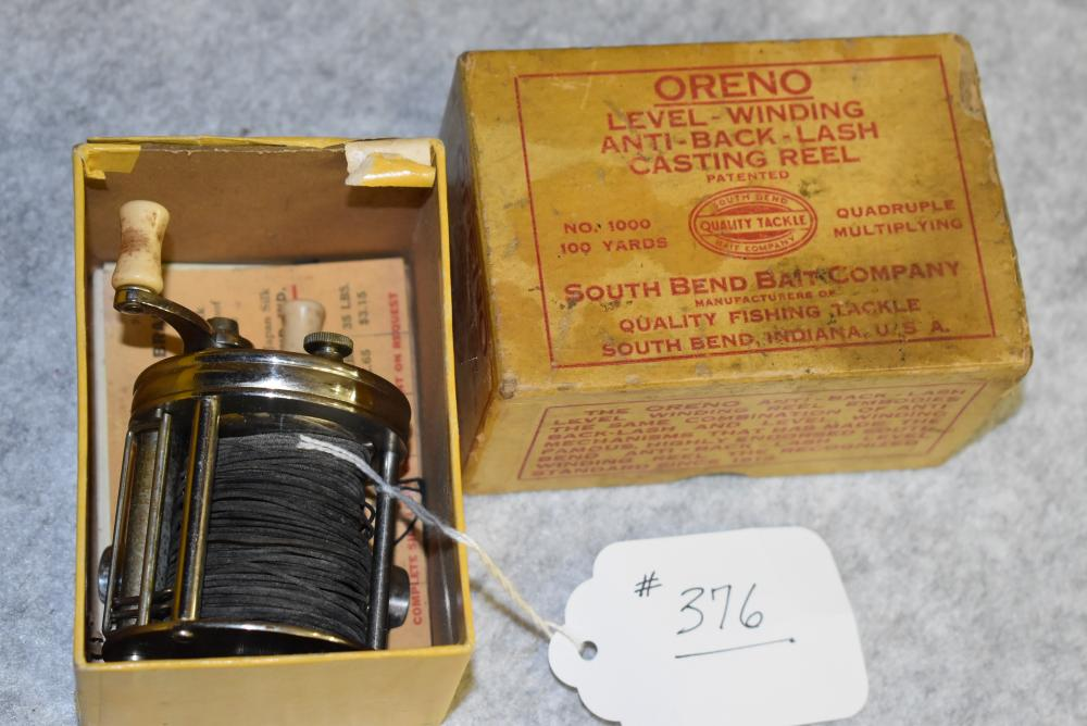 South Bend, early No. 1000 casting reel in the yellow box w red writing. Hang tag, line samples, reel directions. Box shows stains and some small tears.