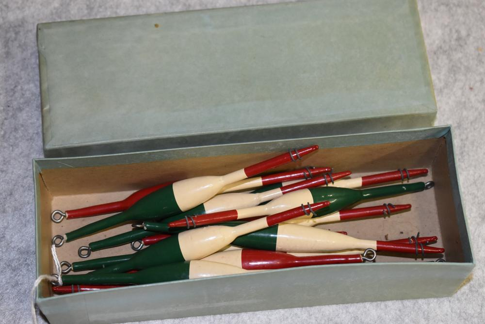 """Dealer box of Ideal fishing floats. 14 remain in the box. Green-white, red-white. Marked 2"""" floats"""