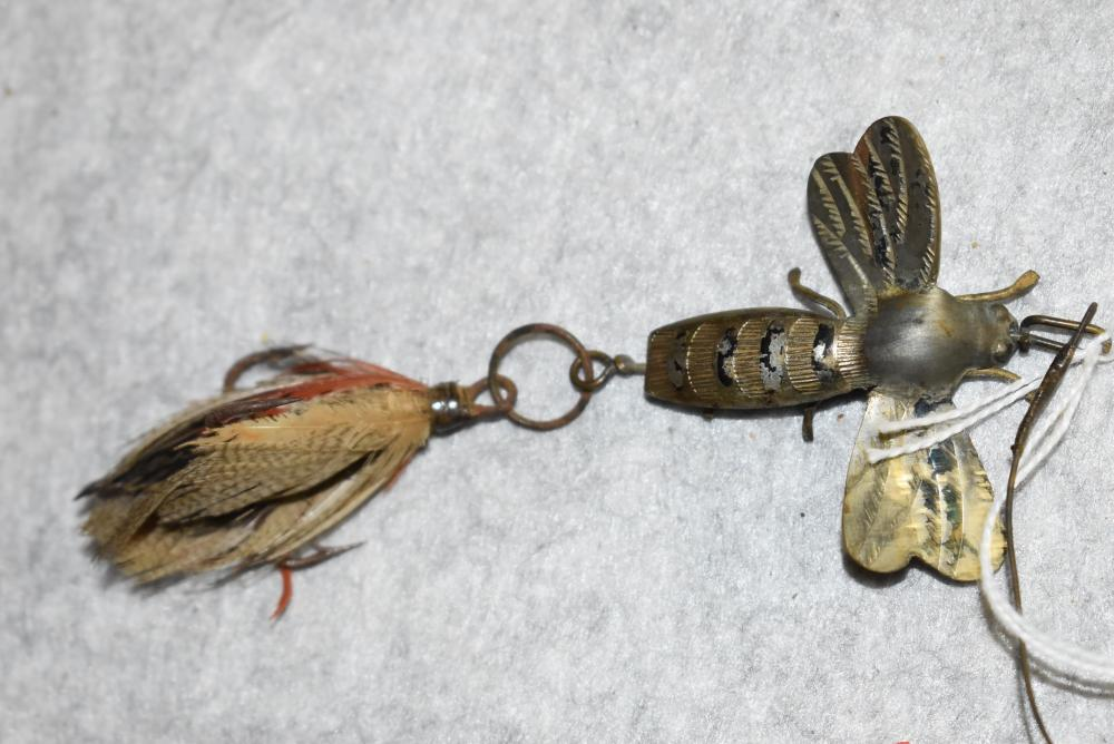 """Unsigned Pflueger May Bug. Has metal body, lead belly. Some paint on the body and under wings. Has the feathered treble hook. Twisted wire leader .measures 1 ¾"""" in length. (VG)"""