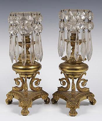 Pair of Regency ormolu and cut glass candlesticks,