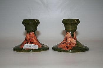 Pair of Moorcroft pottery candlesticks, decorated