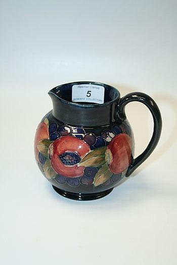 Moorcroft pottery jug decorated in the Pomegranate