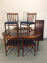 N.O. MOLLER ROSEWOOD DINING TABLE W/2 SKIRTED BOARDS & 6 CHAIRS