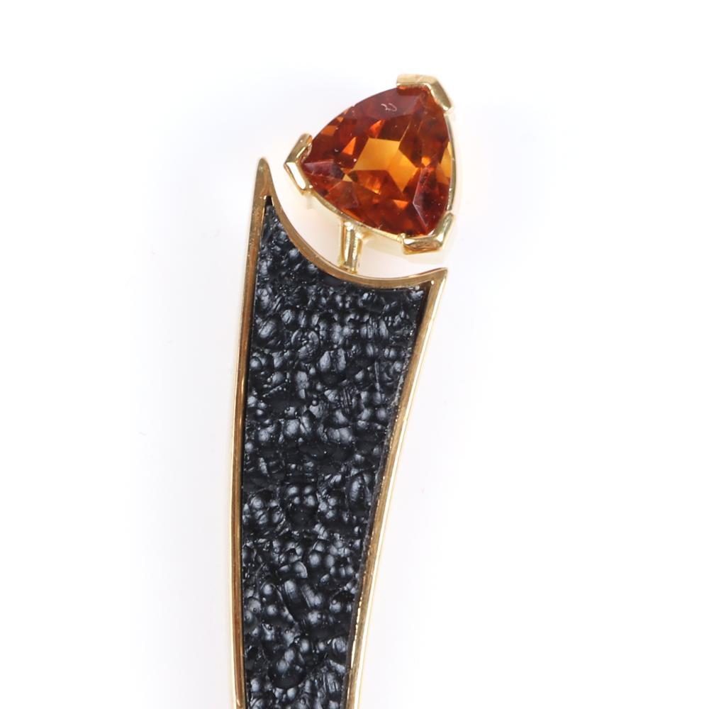 "Stamped 18K yellow gold modernist studio art jewelry pin clip / pendant with inset black Chinese tektite, trillion cut orange citrine and diamond, artist stamp AH. 2 3/4""L"