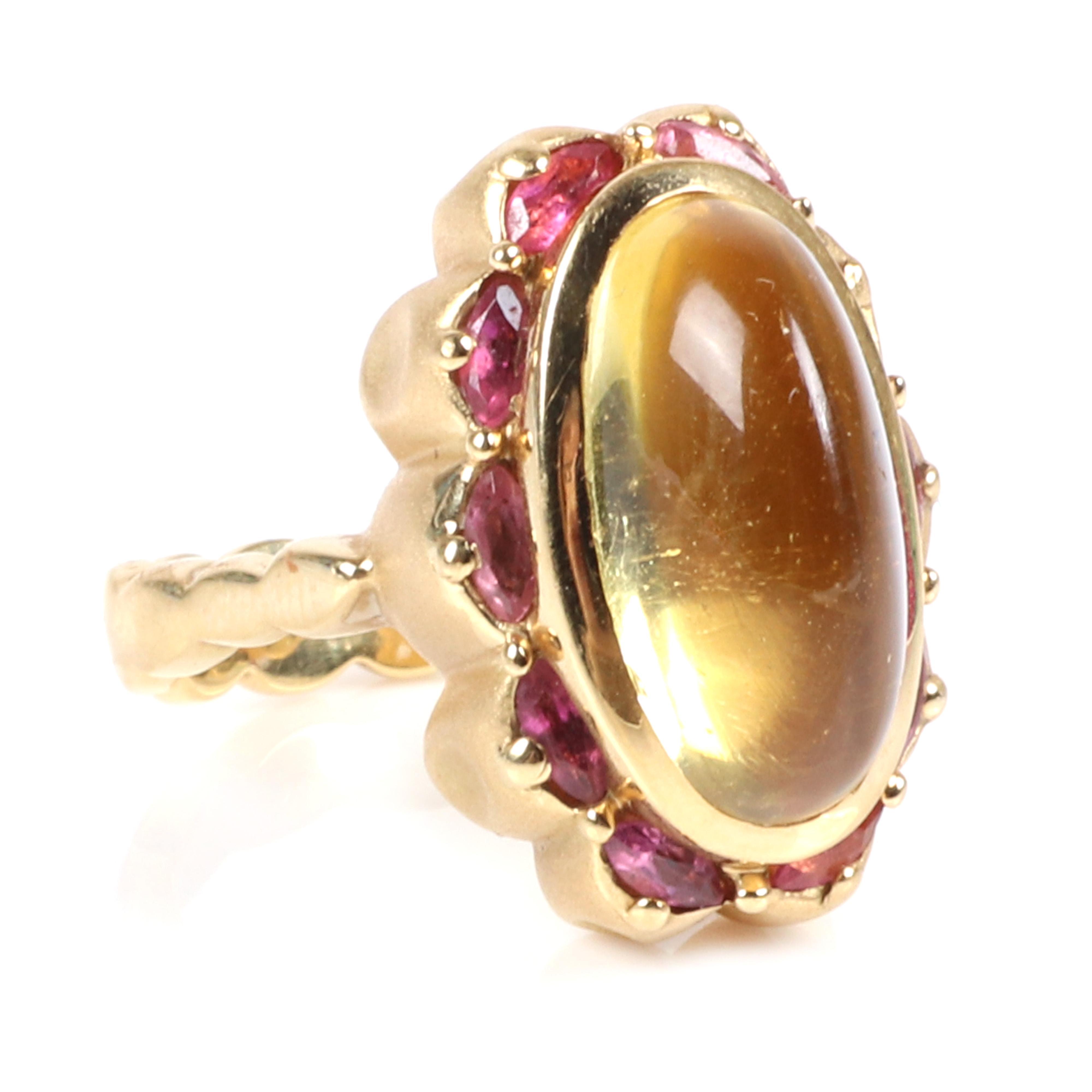 Stamped 18K gold custom designer modern ring with lemon quartz oval cabochon and garnets, 15.07 dwt. Ring Size 6 1/2
