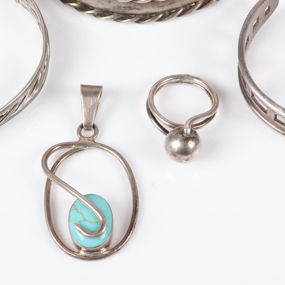 Sterling designer and Mexican silver 5pc group: Mexican sterling pendant with turquoise cabochon, modernist ball ring and three cuff bracelets marked Mexico TV 124, GeoArt 925 and RS. Ring size 6 3/4 (raised ball ring),