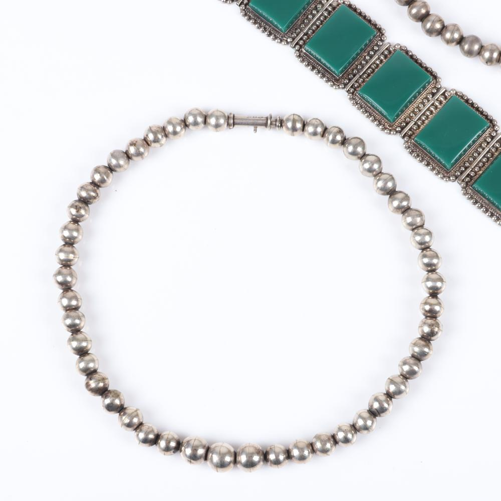 "Sterling silver 5pc Mexican sterling silver jewelry; green onyx panel link bracelet, carved green stone Aztec face earrings, two silver bead choker necklace, and signed NT floral belt buckle. 7""L (bracelet), 14""L (neckla"