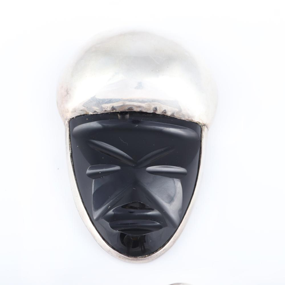 "Vintage Espinosa Mexican Modernist silver and carved black onyx LARGE mask face pin earring set, 1940s. 3""H x 1 3/4""W (pin)"