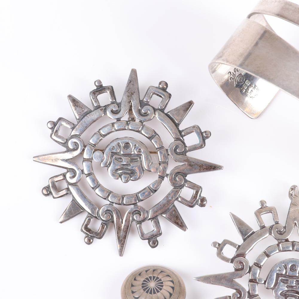 "Mexican Sterling silver 4pc jewelry: Victoria Taxco geometric openwork cuff bracelet, Mexican silver Mayan sun god pin and pendant, Navajo button earrings with whirling eagle niello feather design. 2 1/2"" inner width x 2"