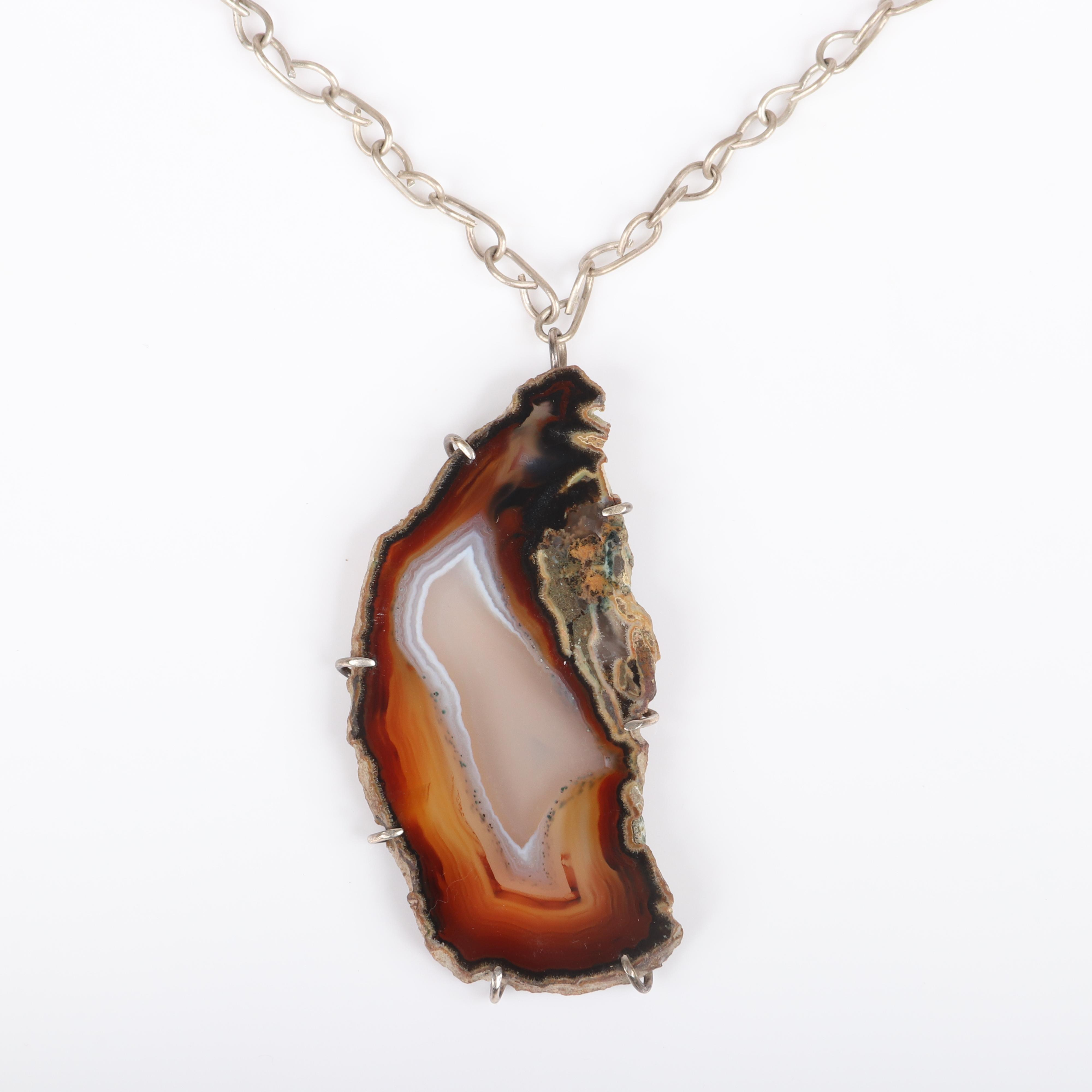 """Mildred Ball American Modernist sterling silver necklace with large sliced and polished natural edge agate pendant and handmade twisted chain and toggle clasp. 18""""L (chain), 3""""H x 1 1/2""""W (pendant)"""