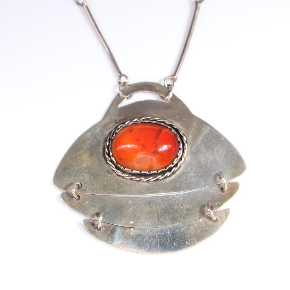 "Mildred Ball American Modernist sterling silver necklace and articulated pendant with central orange colored Mexican fire opal? cabochon, with handmade bar and link chain and toggle clasp. 21""L, 2 1/2""H x 2 1/2""W (pendan"