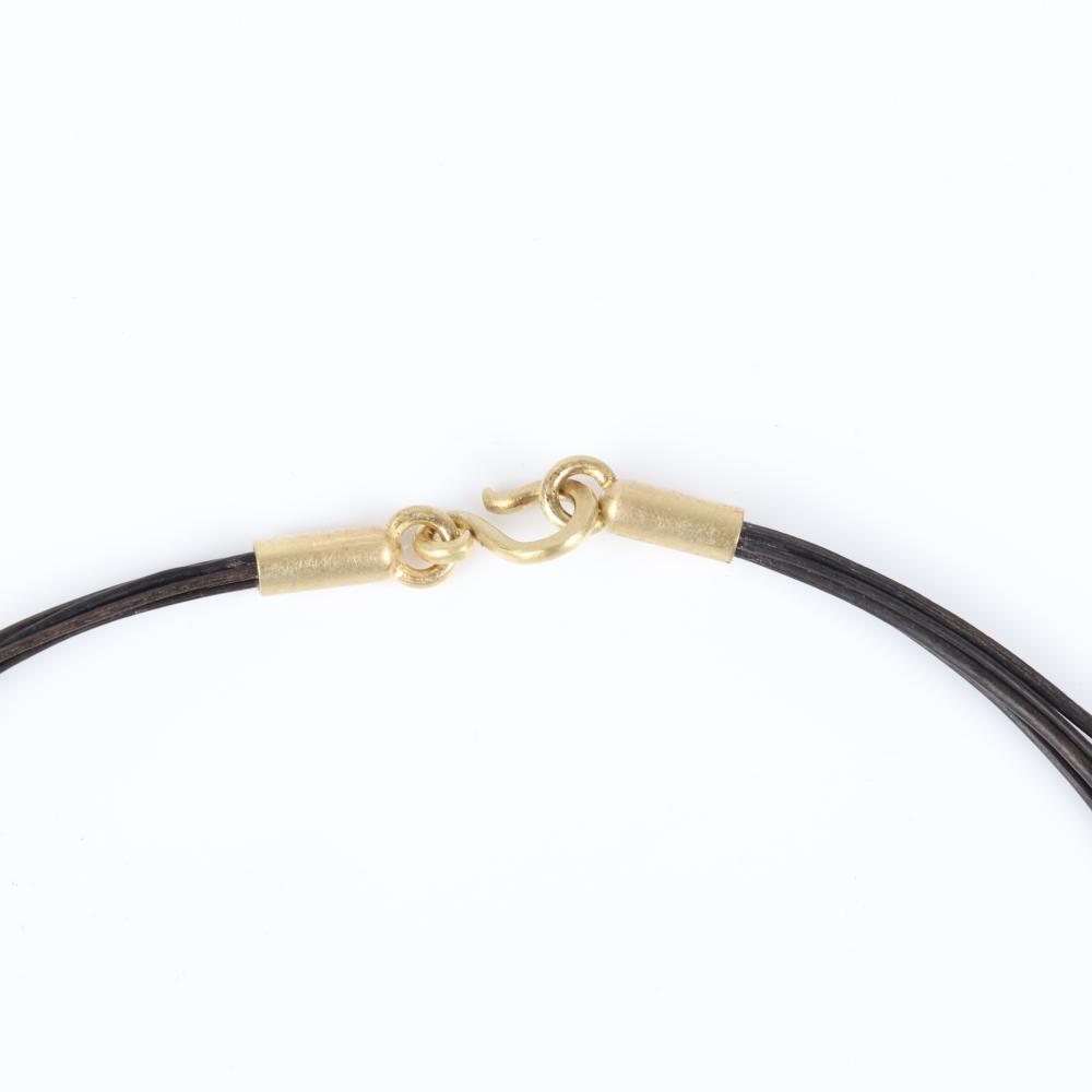 "Studio Artisan art jewelry designer 18K gold and sterling silver pendant with figural gecko encasing magenta geode quartz stone, brushed finish on multi-strand black leather choker. 15 1/2""L, 2""H x 1 1/4"" (pendant)"
