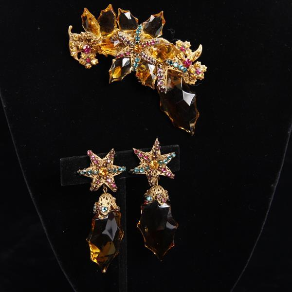 Miriam Haskell 2pc. Asymmetrical Floral Brooch/Pin & Clip Earrings with Amber colored glass & multi-colored jewels.