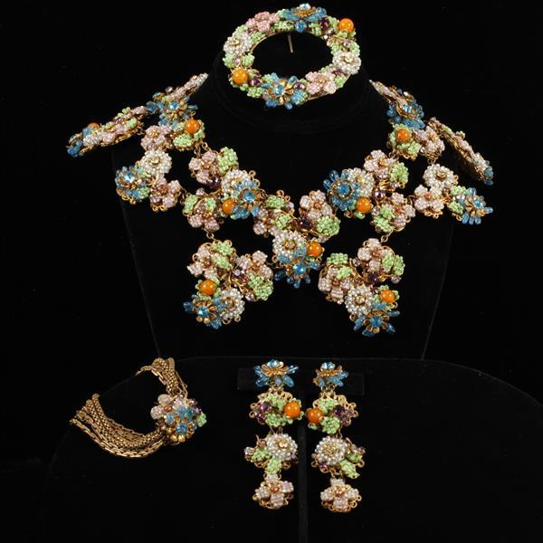 Exceptional and Early Miriam Haskell 4pc. Floral Parure; Collar necklace, brooch, bracelet, & clip earrings. horseshoe mark.