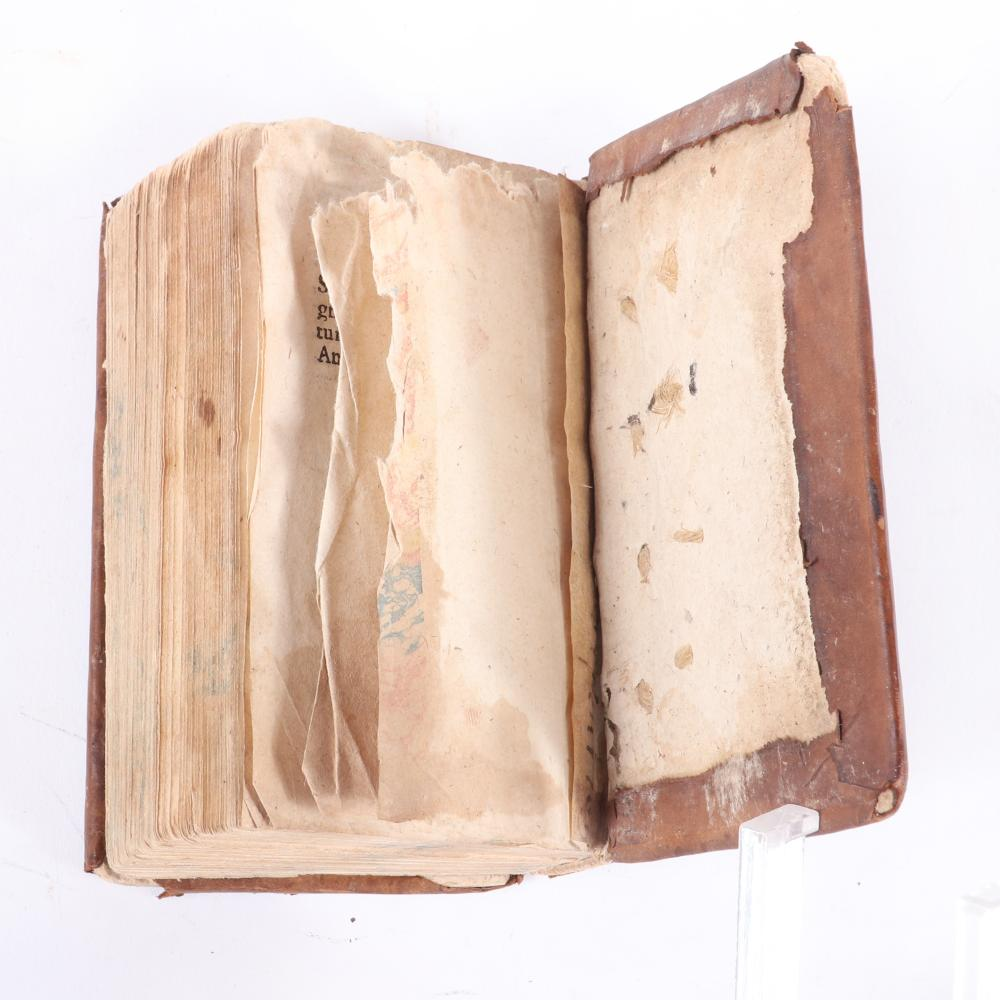 """The Confessions of St. Augustine of Hippo, in latin, pocket sized book, last page dated August 8, 1607, leather bound and gilt. 1""""H x 2 1/2""""W x 4""""D"""