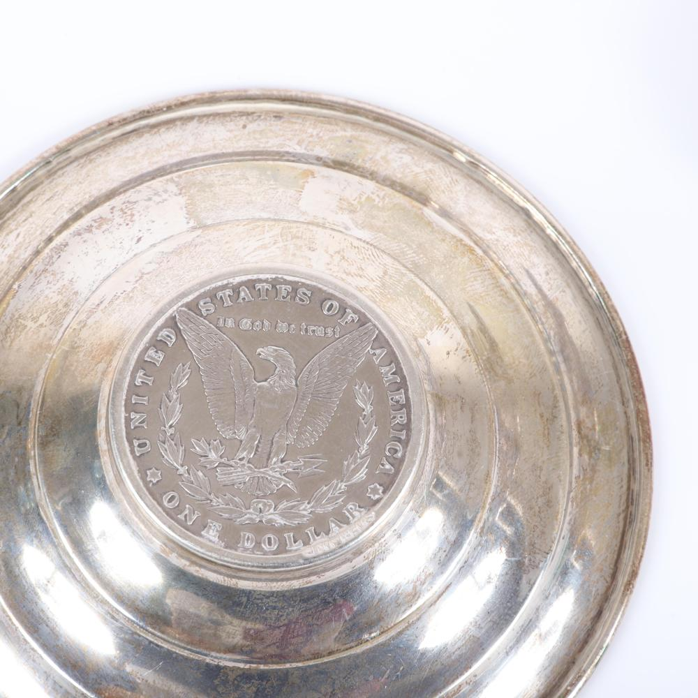 "Wallace sterling floral holloware bowl and sommelier wine tasting cup with 1882 Morgan silver dollar. 6"" diam."