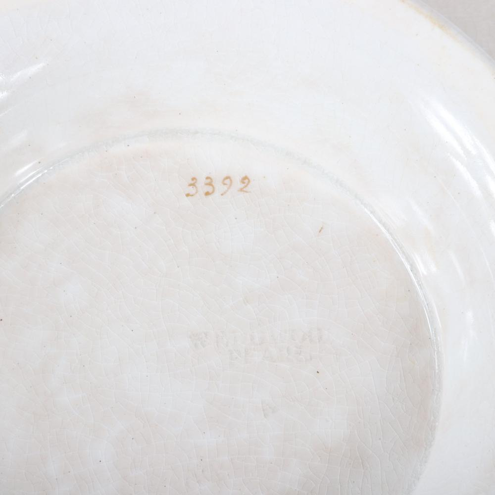 """Wedgwood Pearl dishware with Neo-Classical patterned gilt border decoration. 9 1/4""""H diam."""