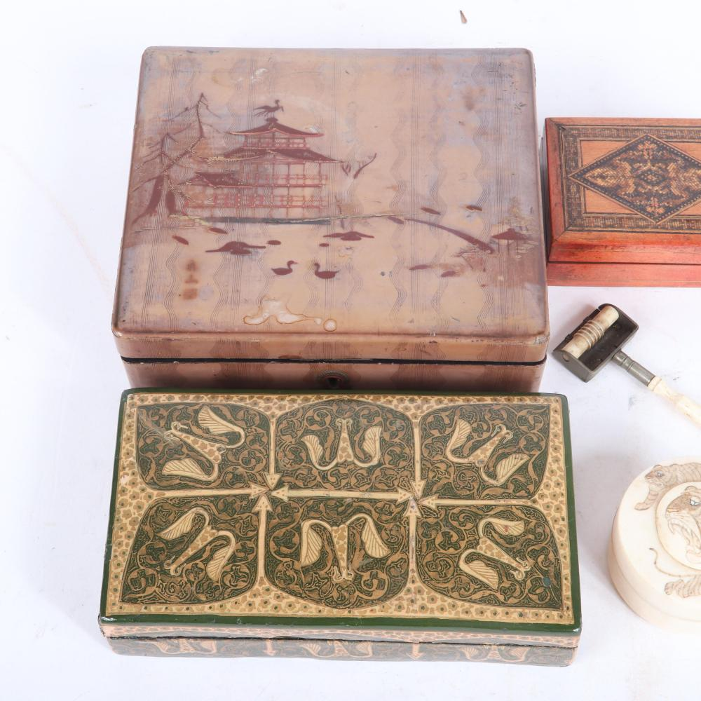 "Antique dresser boxes including Chinese carved bone with scrimshaw leopard motif and screw top, Japanese and Russian lacquer, and North African? inlaid wood. 2 1/4""H x 7""W x 6""D (largest)"