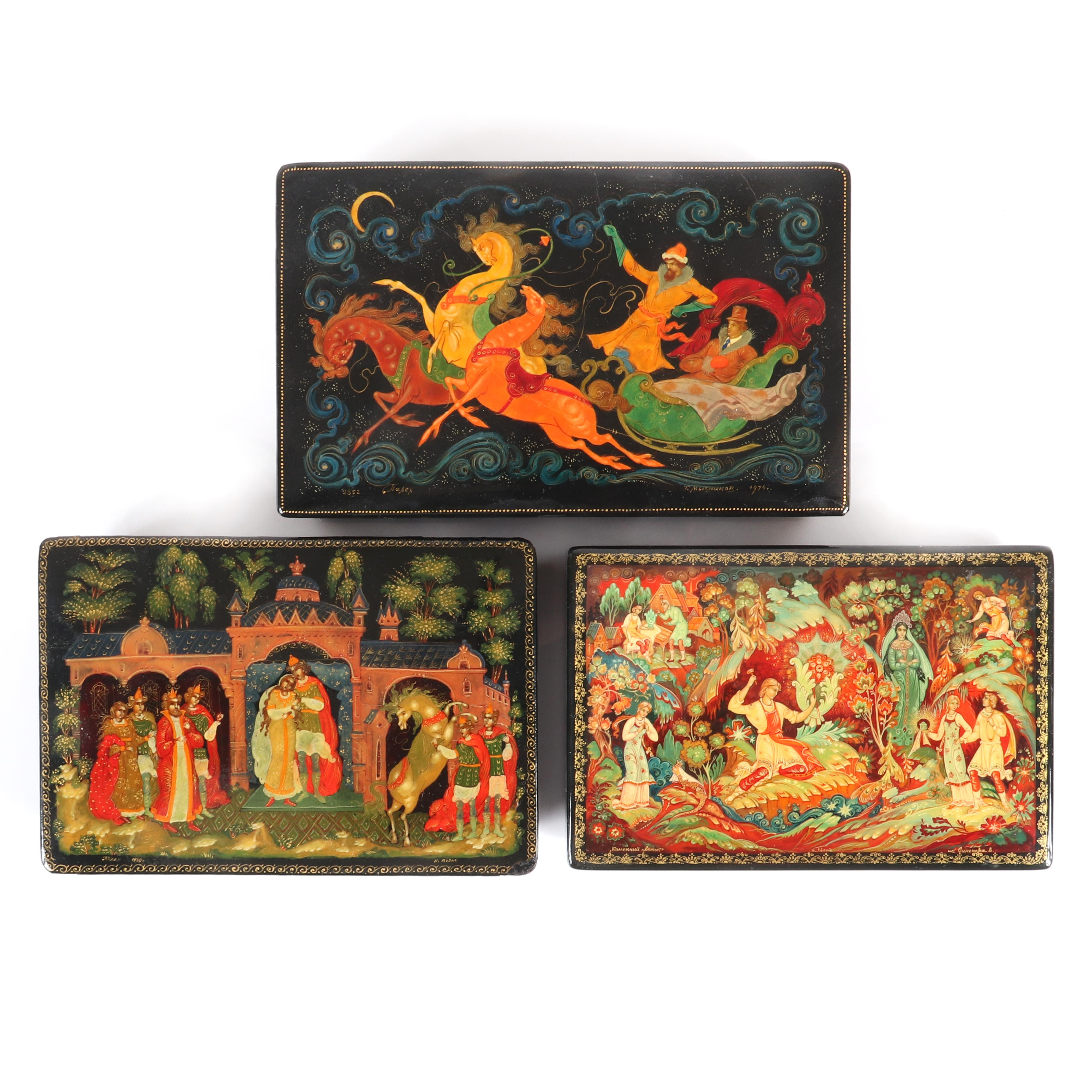 "Three Russian hand-painted lacquer boxes with mythical scenes, one purchased at the Indianapolis Museum of Art, one with certificate created by artist Pogidgen. 1 3/4""H x 7""W x 4""D"