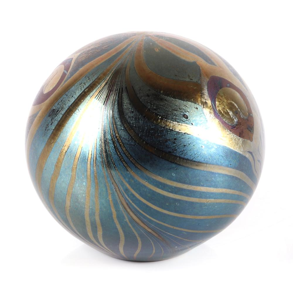 """John Ditchfield Glasform globe paperweight with iridescent peacock feather design on blue glass, with engraved marks: J Ditchfield, Glasform, PW 15., 3 1/2""""diam"""