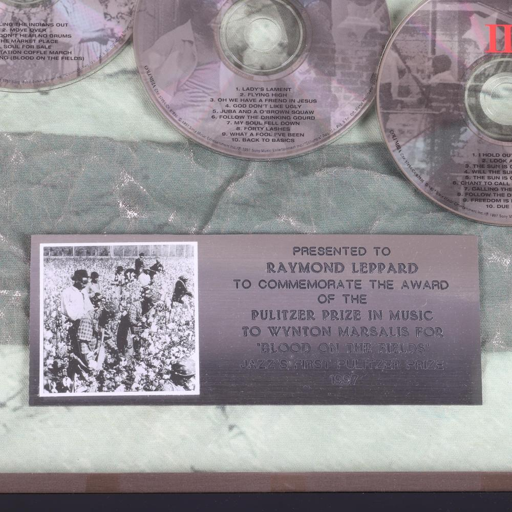 """Two framed recognition pieces presented to Maestro Raymond Leppard, commemorating the award of the 1997 Pulitzer Prize to Wynton Marsalis for """"Blood on the Fields"""", (the first given for jazz), and the Indiana Governor's"""