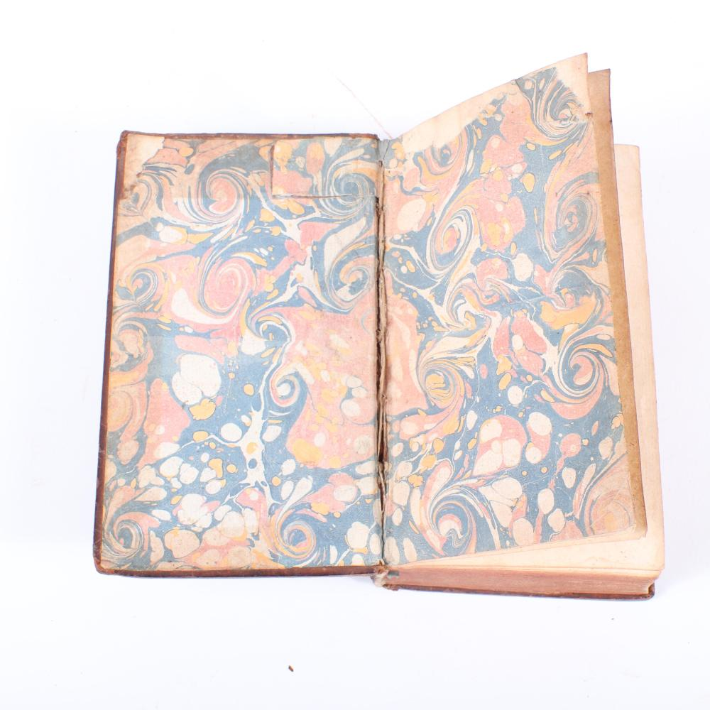 "Two Histoire de La Musique, et De Ses Effets, Tome Premier and Troisieme, A. Amsterdam, Chez M. Charles Le Cene, MDCCXXV, leather bound, with marbled interior and gilt, 1725. 1 1/2""H x 4""W x 6 1/2""D (each)"