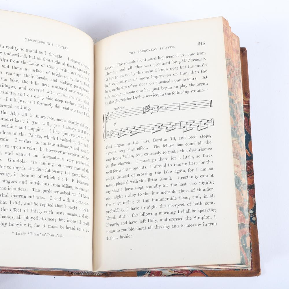 "Two books: Letters of Felix Mendelssohn Bartholdy from 1833 to1847 and Letters from Italy and Switzerland by Felix Mendelssohn Bartholdy, leather bound with gilt and marbled covers. 1 1/2""H x 5""W x 7 3/4""D (each)"