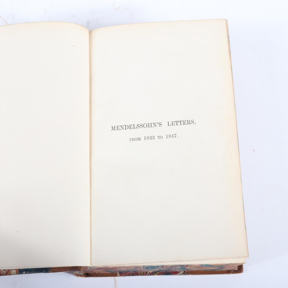 """Two books: Letters of Felix Mendelssohn Bartholdy from 1833 to1847 and Letters from Italy and Switzerland by Felix Mendelssohn Bartholdy, leather bound with gilt and marbled covers. 1 1/2""""H x 5""""W x 7 3/4""""D (each)"""