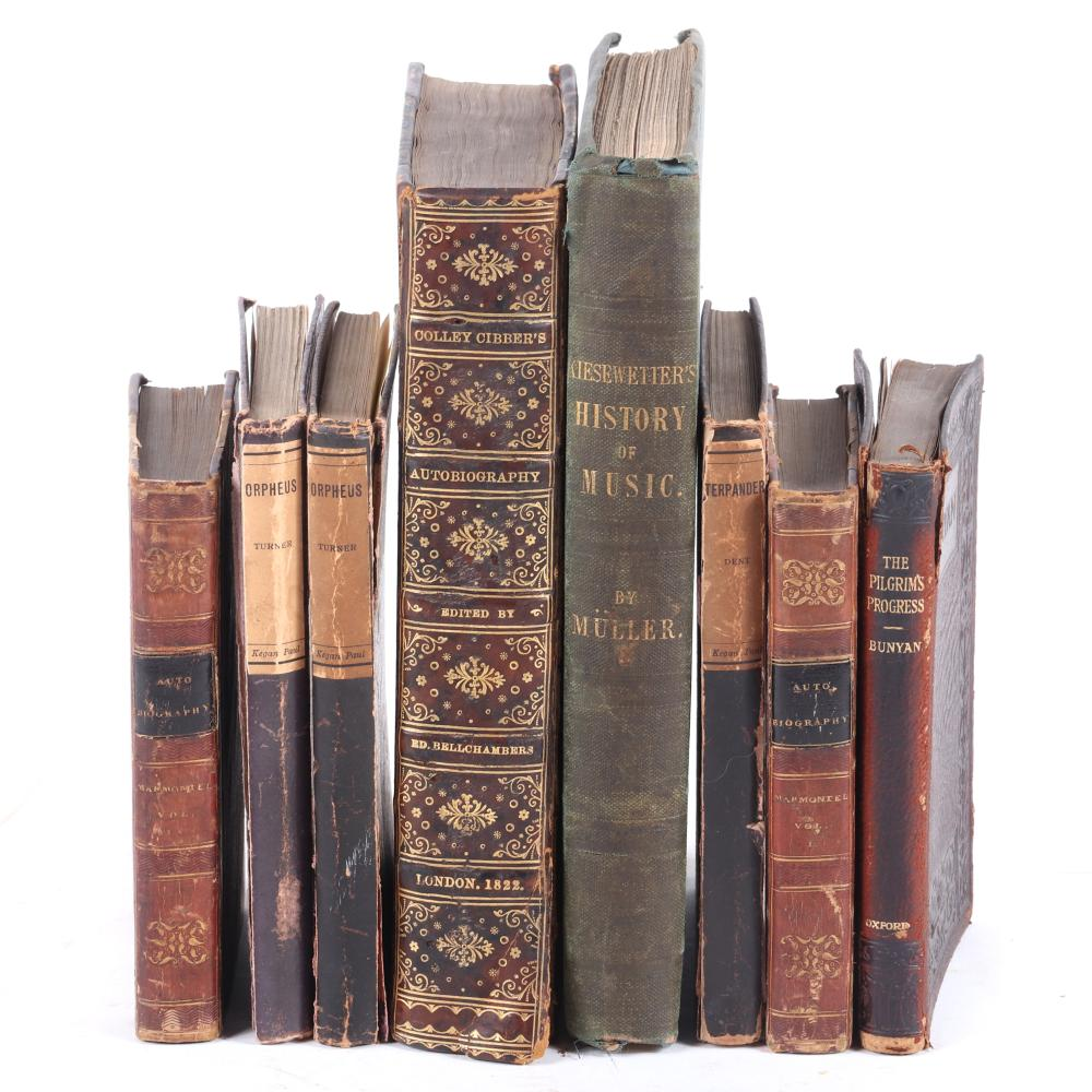 "Eight music themed books: Memoirs of Marmontel, 2 Vol. 1826; Pilgrim's Progress, 1921; Turner's Orpheus and Dent's Terapander or The Music of the Future; Kiesewetter History of Modern Music. 3/4""H x 4""W x 6""D (Pilgrim's"