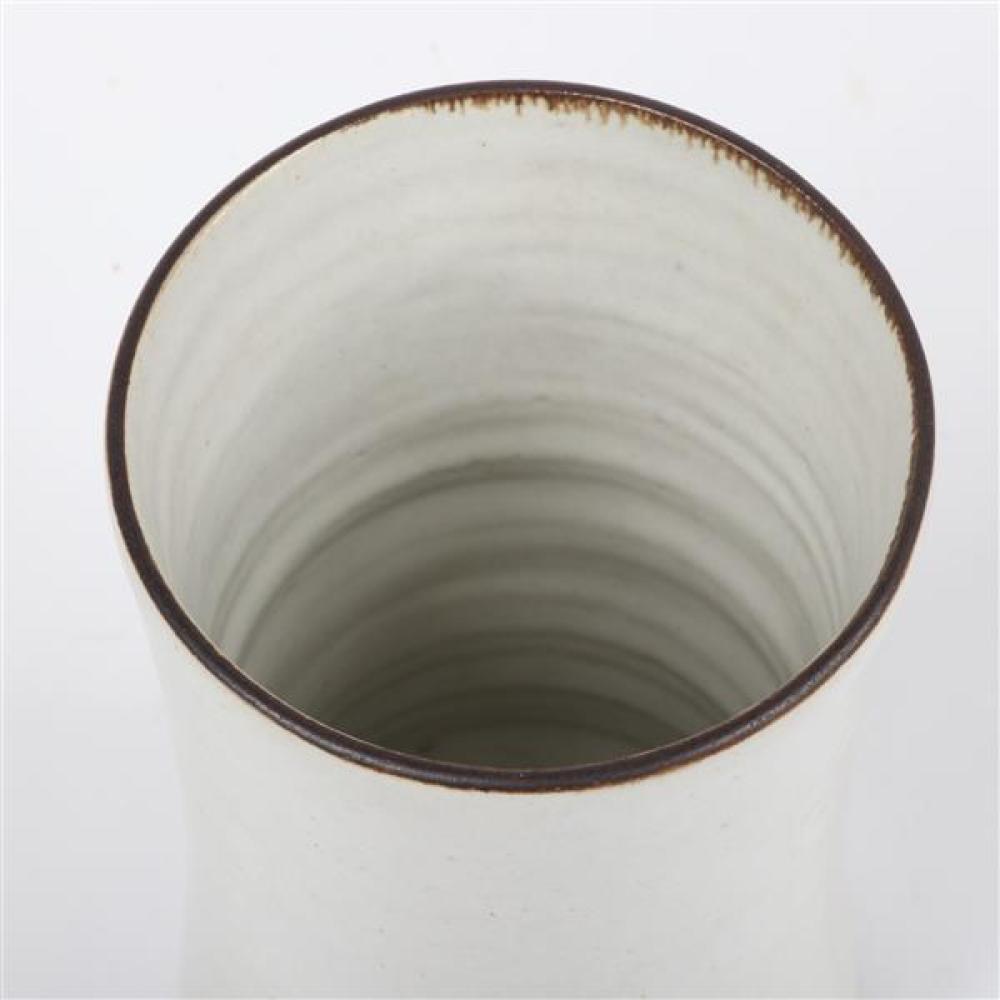 Lucie Rie, (Austrian, 1902-1995), beaker vase, white glaze with copper rim, 5