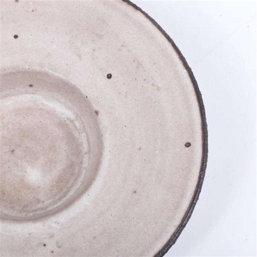 "Lucie Rie, (Austrian, 1902-1995), flare rim bowl, white glaze with manganese flecks and rim, 1 1/4""H x 5""Diam"