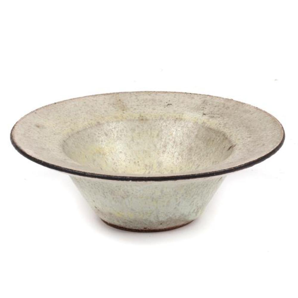"Lucie Rie, (Austrian, 1902-1995), flare rim bowl, flecked cream glaze with manganese rim, 2 1/4""H x 6""Diam"