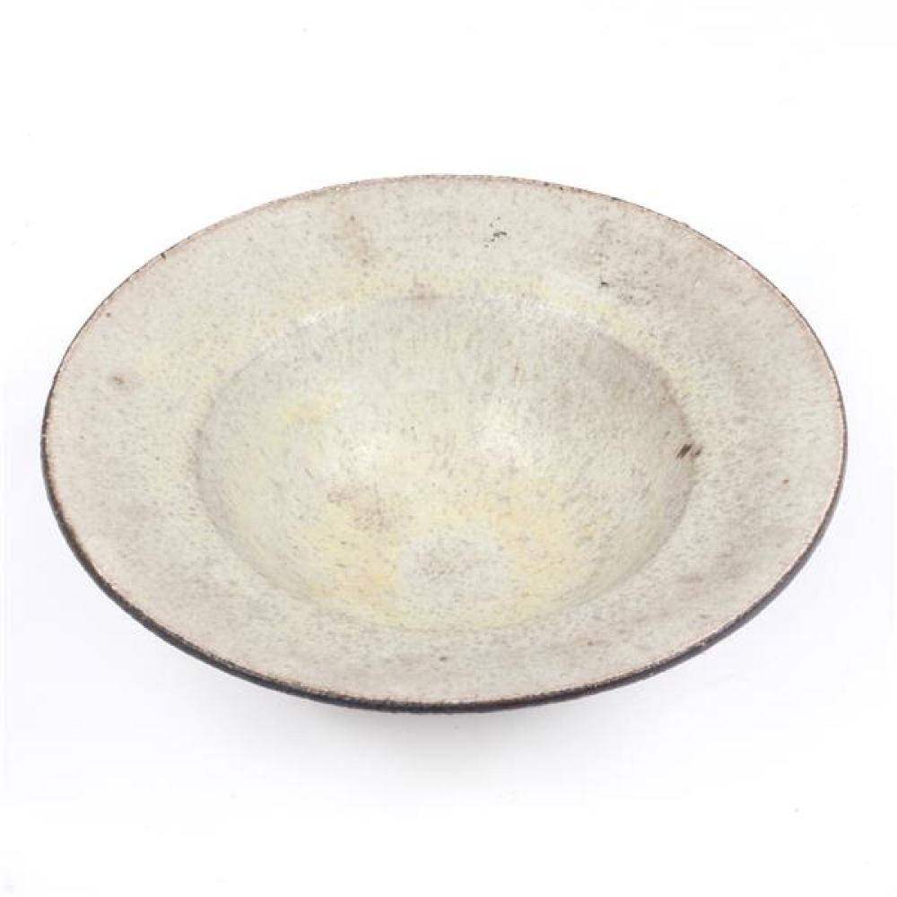 Lucie Rie, (Austrian, 1902-1995), flare rim bowl, flecked cream glaze with manganese rim, 2 1/4