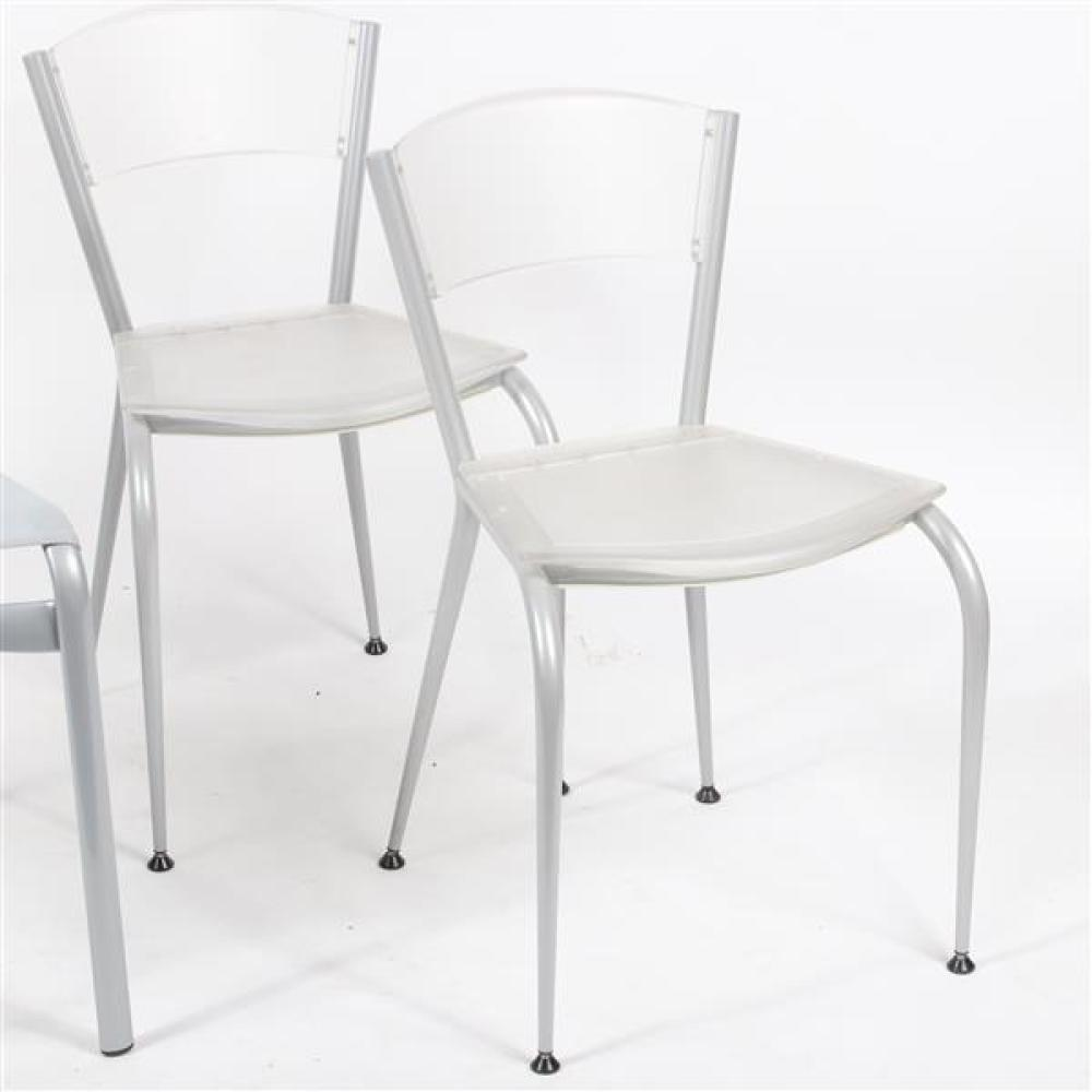 Three modern stackable chairs; pair Baleri Italia 'MiMi' clear plastic dining chairs designed by Enrico Baleri, and Alias 'BigFrame.