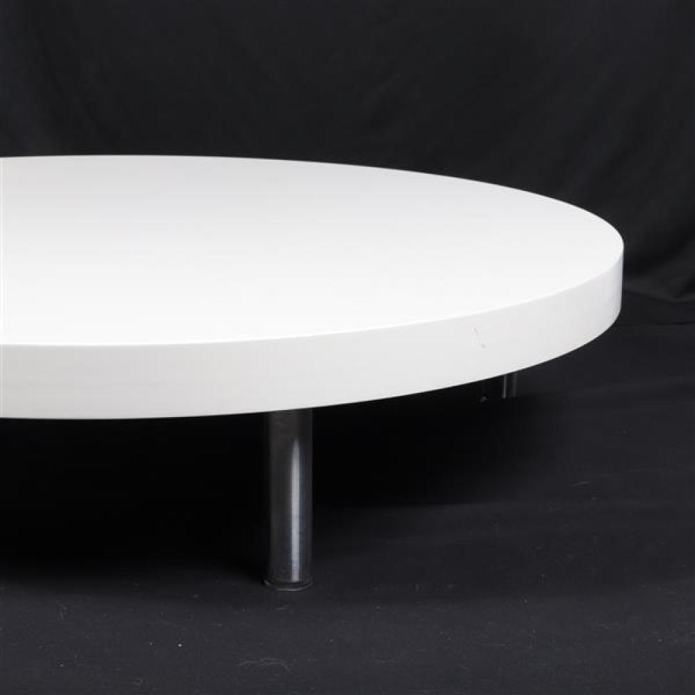 Round art platform, white laminate top and chrome legs.